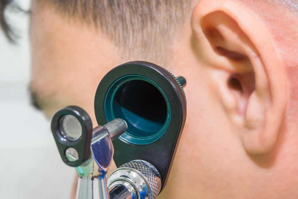 Otoscope On The Ear Of A Patient Inside Mobile Audiology Clinic